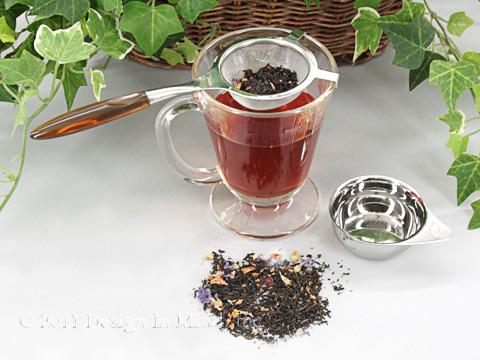 Tea Strainer with brown handle and drip cup