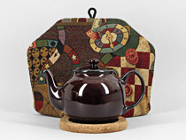 English style teapots designed by Peter Sadler Inc. include ...