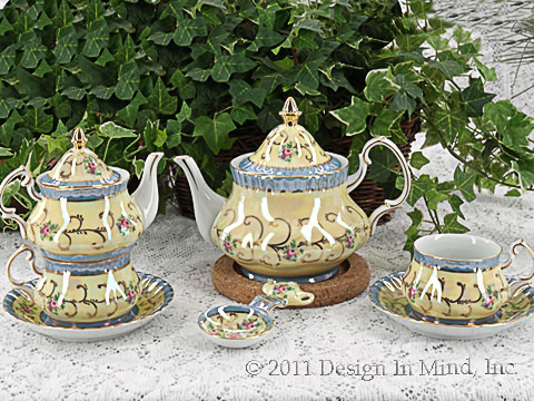 Personal sized porcelain tea sets in a very traditional Victorian style.