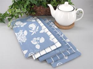 Assorted styles and patterns of kitchen linens.