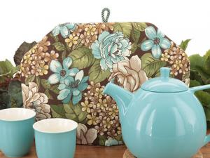 Floral print tea cosies featuring mini, all-over floral prints, chintz style, and all over bouquets of a variety of flowers.